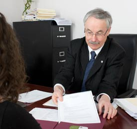 Rick helps a customer with tax preparation services